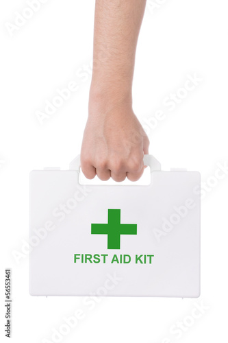 Hand holding a first aid kit isolated on white background.
