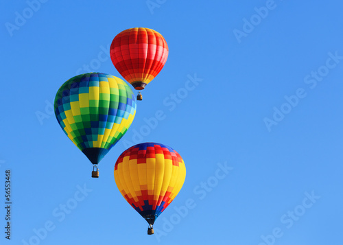hot air balloons against blue sky - 56553468