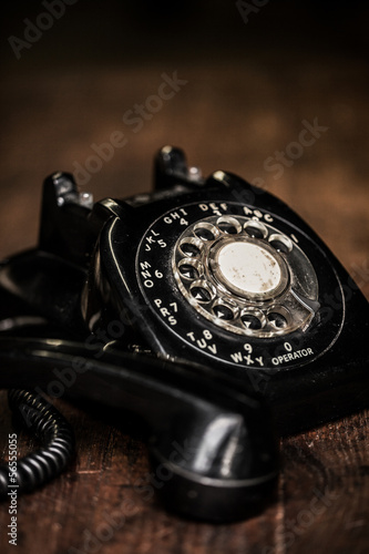 Black vintage telephone on a farm table