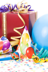 Gift, party hats, horns or whistles, confettis and balloons
