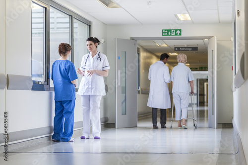 Doctors Nurses Hospital Corridor & Senior Female Patient