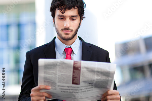 Business man reading a newspaper