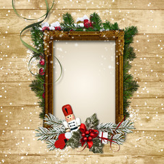 Christmas frame with the decor and the Nutcracker on a wooden ba