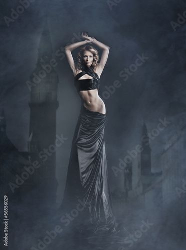 Fashion shoot of a beautiful woman in a long dress