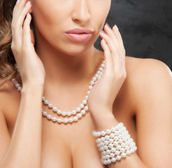 Portrait of a young and beautiful woman wearing pearl jewelry