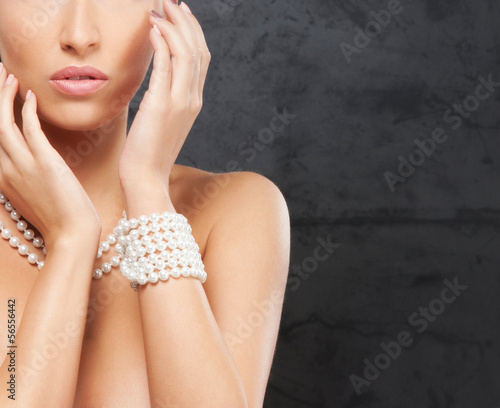 Portrait of a young and beautiful woman in pearl jewelry