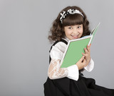 cute girl happy to read a book