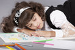 cute girl sleep with her colorful drawing