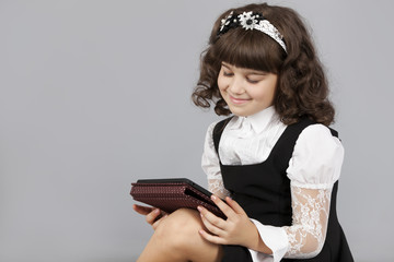cute girl happy to read a electronic book