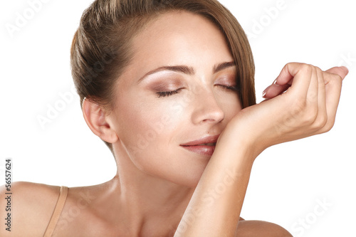 beautiful brunette female model smelling her perfume