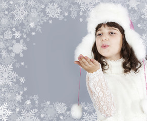 cute girl white dressing blow snowflakes