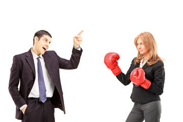 Angry businessman having an argument with a businesswoman