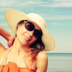 Relaxing beach woman enjoying the summer