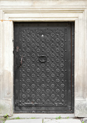 retro gate with door knocker, decorated with wrought iron