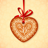 Vector gingerbread heart on red ribbon