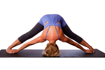 Head on floor yoga inversion pose