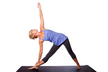Beautiful woman doing Triangle yoga pose