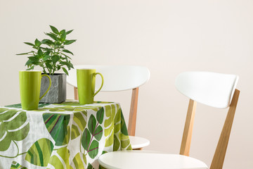 Bright green table with teacups