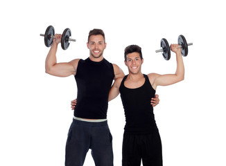 Two friends training with dumbbells