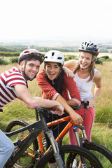 Group Of Young People Cycling In Countryside