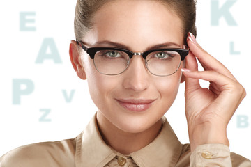 close up of a young smiling beautiful woman wearing eyeglasses