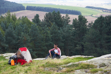 Young Man On Camping Trip In Countryside