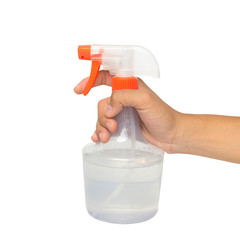 Hand holding a spray bottle with laundry detergent isolated over