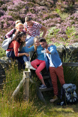 Group Of Young People Taking Photograph On Hike