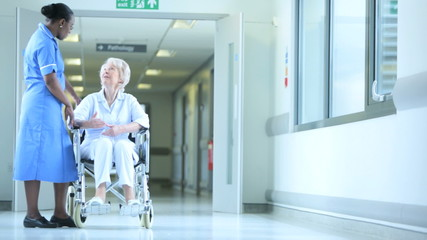 Medical Staff Talking Senior Female Hospital Patient