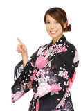 Asian woman wearing kimono and pointing up