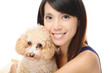 Asian woman with poodle dog