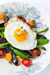 Egg on fresh healthy vegetables light meal brunch option