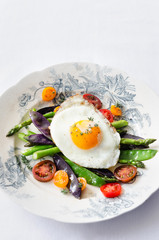 Egg on fresh healthy vegetables light meal option