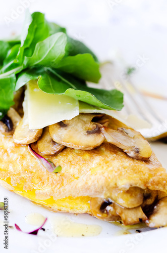 Omelette folded with mushrooms and fresh rocket