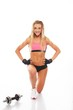 Sporty woman with dumbbell doing fitness exercise