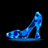 Icon crystal shoes on a dark background with space for text