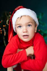 Happy small boy in santa hat