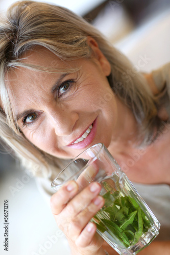 Senior woman drinking verbena tea