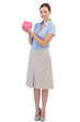 Cheerful businesswoman with piggy bank