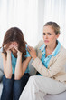 Crying woman with her therapist