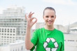 Natural pretty environmental activist making okay gesture