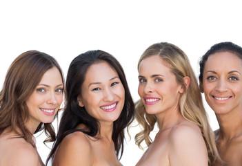 Nude models posing and looking at camera