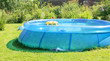 Leinwanddruck Bild - Inflatable swimming pool in a garden