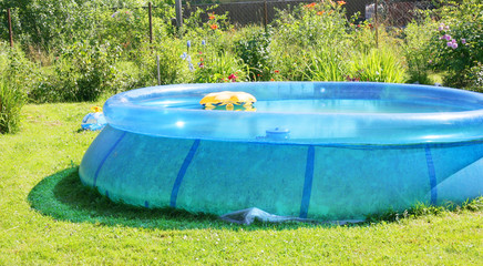 Inflatable swimming pool in a garden