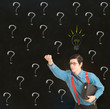 Nerd businessman  with chalk question marks ideas