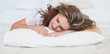 Woman sleeping in cosy bed