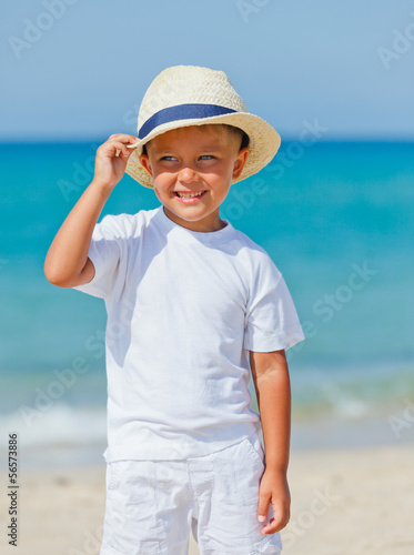 Boy with hat on the beach