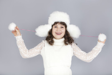 cute happy girl play with winter hat