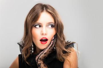 Surprised brunette woman