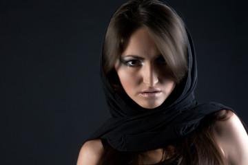 Girln in the shawl look at the camera